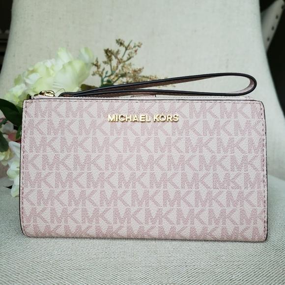 Michael Kors Handbags - NWT Michael Kors Double zip Wristlet Ballet Pink